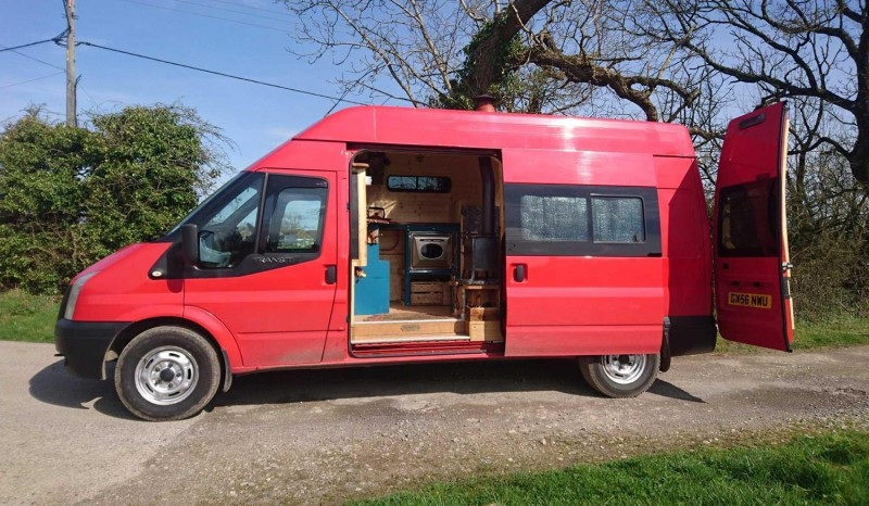 Former fire-and-rescue van transformed into unique campervan with wood burning stove, TV and oven